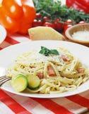 Pasta carbonara on the wooden table Stock Photos