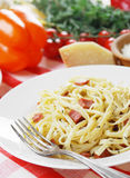 Pasta carbonara on the wooden table Royalty Free Stock Photo