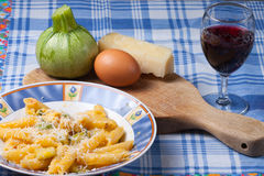 Pasta carbonara. Pasta with zucchini, eggs and sheep cheese typical traditional Italian dish Stock Photos