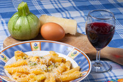 Pasta carbonara. Pasta with zucchini, eggs and sheep cheese typical traditional Italian dish Royalty Free Stock Photo
