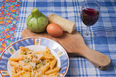 Pasta carbonara. Pasta with zucchini, eggs and sheep cheese typical traditional Italian dish Stock Images
