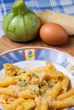 Pasta carbonara. Pasta with zucchini, eggs and sheep cheese typical traditional Italian dish Royalty Free Stock Image