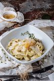 Pasta with carbonaria, spaghetti with hard parmesan and cheese-sauce. Traditional Italian cuisine. Pasta al-Carbonara stock photo