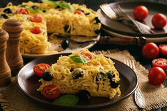 Pasta casserole with tomatoes, olives and cheese. royalty free stock images