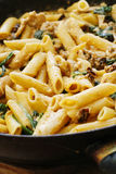 Pasta cereals with cabbage in black pan.  Royalty Free Stock Photography