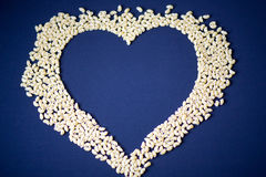 Pasta and cereals. Heart of cereals and pasta on a blue background. Pasta and cereals Royalty Free Stock Images