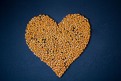 Pasta and cereals. Heart of cereals and pasta on a blue background. Pasta and cereals Stock Photos