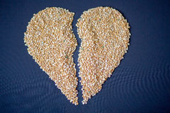 Pasta and cereals. Heart of cereals and pasta on a blue background. Pasta and cereals Stock Image