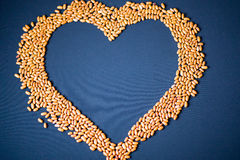 Pasta and cereals. Heart of cereals and pasta on a blue background. Pasta and cereals Royalty Free Stock Photo