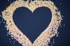 Pasta and cereals. Heart of cereals and pasta on a blue background. Pasta and cereals Stock Photo