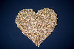 Pasta and cereals. Heart of cereals and pasta on a blue background. Pasta and cereals Stock Photography