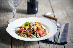 Pasta with chanterelle mushrooms, prosciutto and truffles Stock Image