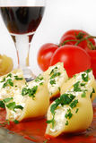 Pasta with cheese. Pasta shells stuffed with ricotta and mozzarella cheese stock image