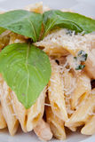 Pasta with cheese and basil Stock Photography