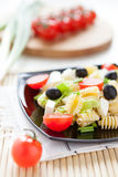 Pasta with cheese and cherry tomatoes Royalty Free Stock Image