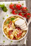 Pasta with cheese and cherry tomatoes Stock Photos
