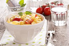 Pasta with cheese and cherry tomatoes Stock Image