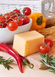 Pasta, cheese and fresh vegetables Stock Photography