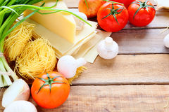 Pasta, cheese and fresh vegetables Royalty Free Stock Image