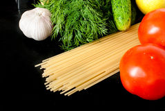 Pasta, cheese and fresh vegetables Stock Photos