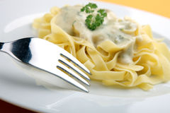 Pasta with cheese sauce with fork Stock Image