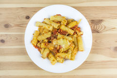 Pasta with cheese and sauce in plate stock images