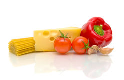 Pasta, cheese and vegetables on white background Stock Photography