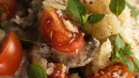 Pasta with cherry, cheese and basil. Video. Horizontal stock video footage