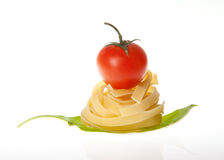 Pasta cherry tomato garlic and basil Royalty Free Stock Photos