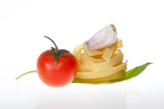 Pasta cherry tomato garlic and basil Royalty Free Stock Images