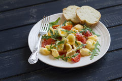 Pasta with cherry tomatoes, arugula and Parmesan Royalty Free Stock Photography