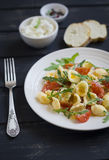 Pasta with cherry tomatoes, arugula and Parmesan Royalty Free Stock Images