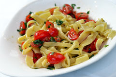 Pasta with cherry tomatoes and basil Stock Photo