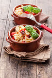 Pasta with cherry tomatoes and olives wooden table Stock Photography