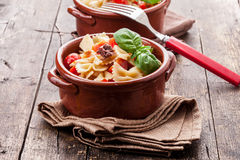 Pasta with cherry tomatoes and olives wooden table Royalty Free Stock Photography