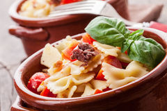 Pasta with cherry tomatoes and olives wooden table Royalty Free Stock Photo
