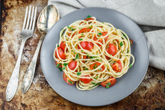 Pasta with cherry tomatoes and parsley Stock Photography