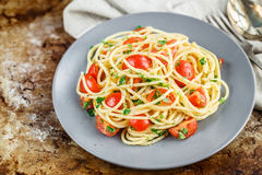 Pasta with cherry tomatoes and parsley Royalty Free Stock Photo