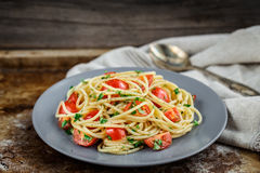 Pasta with cherry tomatoes and parsley Royalty Free Stock Photography
