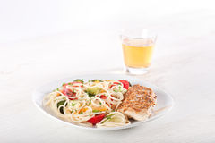 Pasta and chicken breast Royalty Free Stock Photography