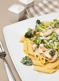 Pasta with chicken and broccoli dish Stock Images