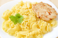Pasta and chicken cutlet Royalty Free Stock Images
