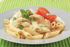 Pasta, chicken meat and cream sauce Stock Images