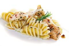 Pasta with chicken meat isolated on white Stock Images