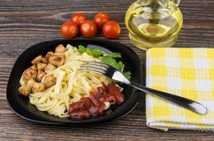 Pasta with chicken meat, ketchup and parsley, bottle of oil Stock Photography