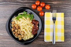 Pasta with chicken meat, ketchup and parsley in plate Stock Photography