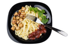 Pasta with chicken meat, ketchup and parsley on white Royalty Free Stock Photo
