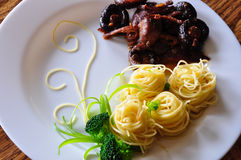 Pasta with chicken and shiitake mushroom Stock Photos