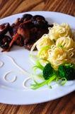 Pasta with chicken and shiitake mushroom. Pasta with chicken, shiitake mushroom, and broccoli royalty free stock photo