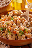 Pasta with chickpeas and vegetables Stock Photos